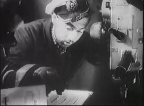 Oblt. Hans-Jürgen Hellriegel by the night periscope in the control room of U 96 identifies target