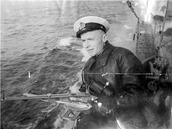 Mikhail Ivanovich Danevich with torpedo director on the bridge of soviet submarine Щ-125