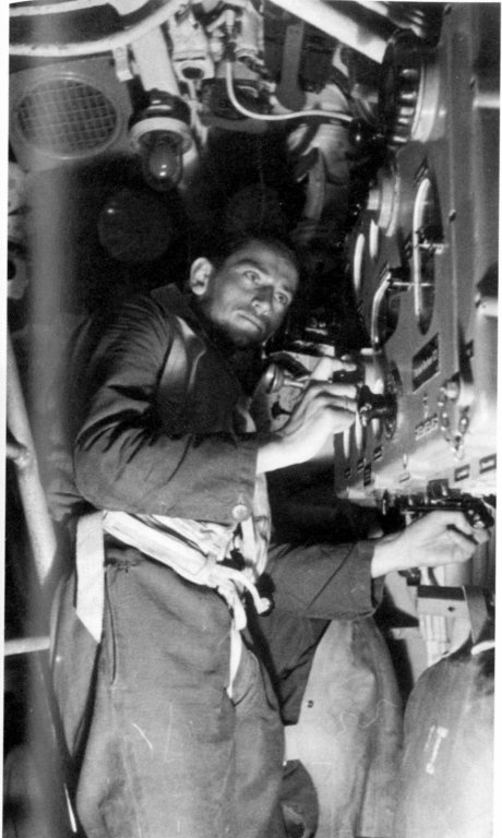 Oberbootsmann Heinz Webendörfer operates the torpedo data computer in U 564's conning tower