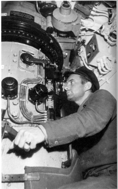 KrvKpt. Reinhard Suhren at the attack periscope in U 564's conning tower (the single azimuth circle is visible)