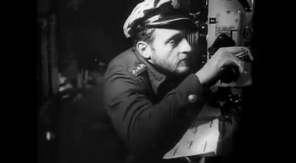KrvKpt. Erich Topp by the night periscope in the control room of U 552 identifies target