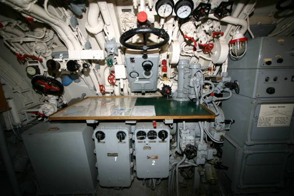 The components of the torpedo fire control system in U 995's control room – visible are the control boxes of the aiming and torpedo firing subsystems, the main distribution box, target follow-up switch and timing control box