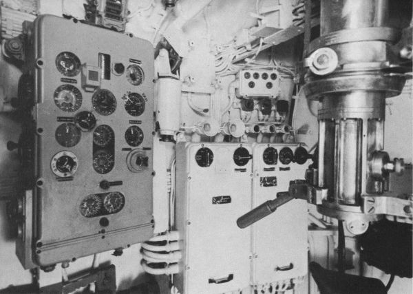 The elements of the torpedo fire control system in U 505's conning tower, visible are the TDC, control boxes and control lamps